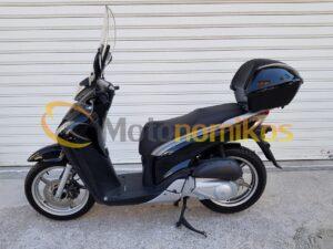 Μεταχειρισμένο Honda SH125 SH 125 μαύρο με μπαγκαζιέρα και ζελατίνα μοντέλο 2011 αριστερή μεριά-min